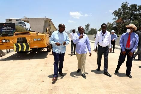 From left: Chief of Staff at the Office of the President, Nzioka Waita, Transport Cabinet Secretary, James Macharia, and Political Analyst Mutahi Ngunyi inspecting the construction of the Nairobi Expressway on September 29, 2021.