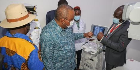 President Uhuru Kenyatta with Raila odinga inspecting NMS hospital in Kibra on September 29,2021