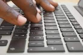 Image of fingers typing into a keyboard
