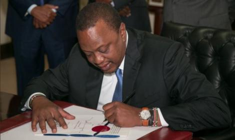 President Uhuru Kenyatta Signing Government Documents