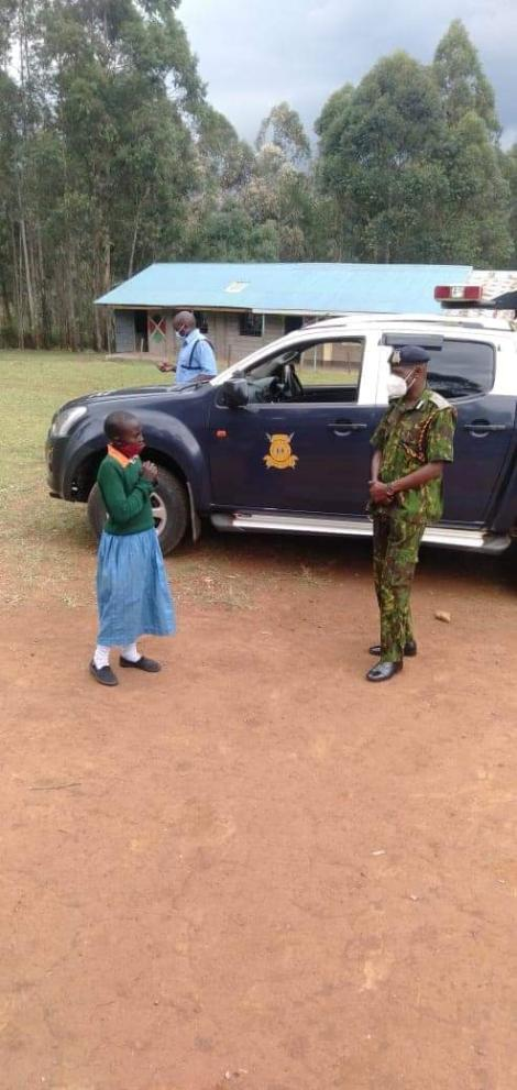 Kisii Police Boss Francis Kooli with a Viral Girl Reading while Herding Cows on September 19