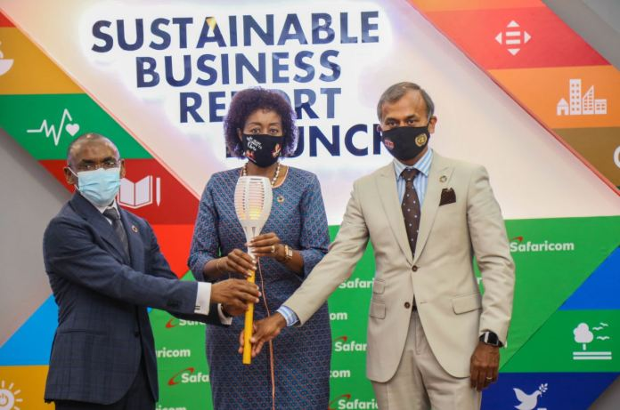 From left, Safaricom PLC CEO Peter Ndegwa Melvin Marsh International CEO Flora Mutahi and UN Resident Coordinator Siddharth Chatterjee pass on the Sustainability torch during the Safaricom PLC 2020 Sustainability report launch