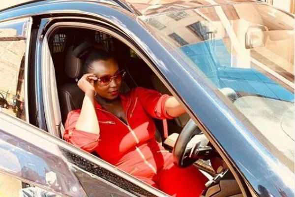Catherine Kamau (Pictured) in her new BMW gifted by her husband Philip Karanja