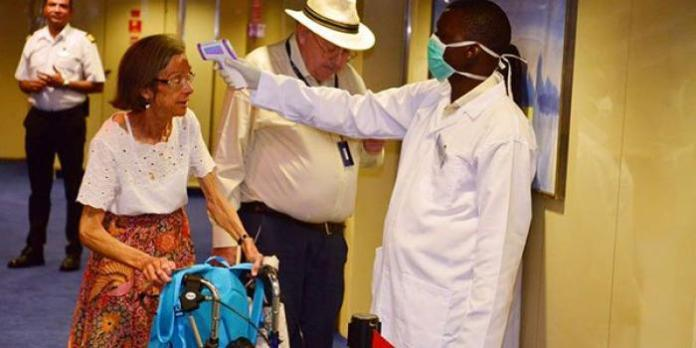 A tourist is screened for Coronavirus at the Port of Mombasa on February 13, 2020