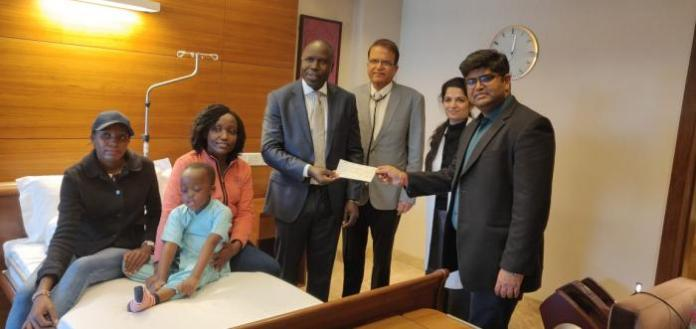 Ethan Macharia, his mother Veronica Njeri (pink), officials from the Kenyan Embassy in India and his doctors at the Forties hospital on Friday, February 28, 2020.