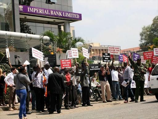 Imperial Bank depositors hold placards outside the Westlands branch in a peaceful demonstration in 2019