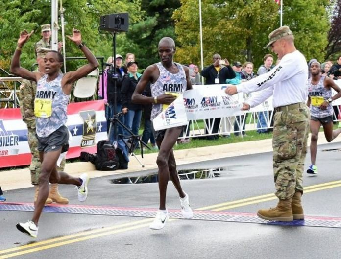 Marathon runner Sgt. Augustus Maiyo (left) wins in the male's overall and male's military categories at the Army Ten-Miler, Oct. 9, 2016, in Arlington, USA.