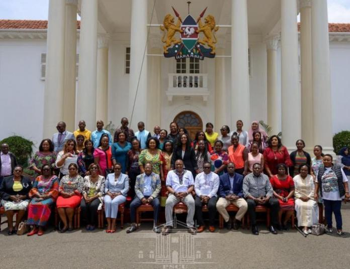 President Uhuru Kenyatta (centre) with Nairobi Governor Mike Sonko (to his right) pose alongside his Members of the Nairobi County Assembly at State House on February 29, 2020.