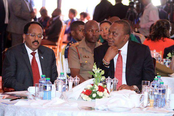 President Uhuru Kenyatta (right) and his Somalia counterpart Mohamed Abdullahi Farmaajo follow proceedings during Kenya's 16th annual National Prayer Breakfast at Safari Park hotel in Nairobi on May 31, 2018.