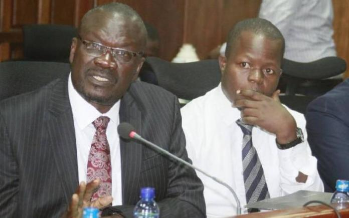 Siaya Governor Cornell Rasanga and his Finance Director Daniel Nyonje respond to audit queries at Parliament on August 6, 2018.