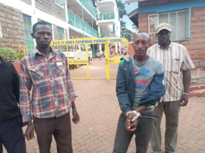 Peter Muiya after being apprehended by Murang'a County residents on Thursday, Friday 13