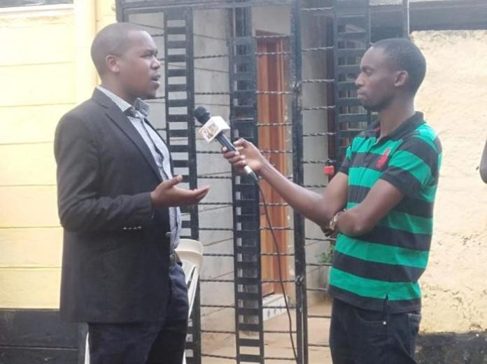 Peptang CEO Joseph Choge (left) is interviewed by a K24 reporter after addressing the