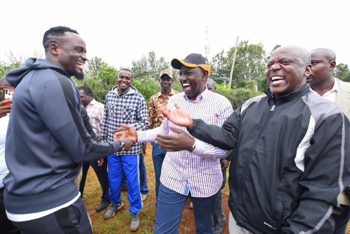 Former footballer Mcdonald Mariga (left) welcomes Deputy President William Ruto during the Mumboha Hustlers Cup in Luanda, Vihiga County on Monday, December 23, 2019.