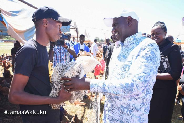 William Ruto buys a cock at At Kambi Kuku, Uasin Gishu County, during the 2nd edition of chicken auction, which raised Sh11 million in December 2019
