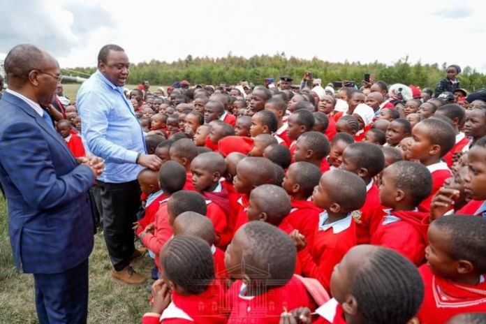 President Uhuru Kenyatta addresses pupils at Kenyatta Road Primary School in Nyandarua County on Friday, January 31,