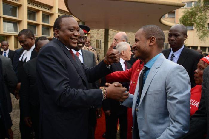 President Uhuru Kenyatta and Babu Owino shake hands on May 2, 2018. Babu asked the President to write off student loans owed to HELB.