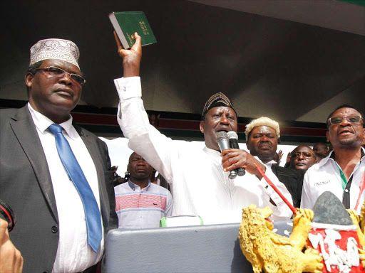 Raila Odinga swears himself in flanked by Miguna Miguna TJ Kajwang' and James Orengo