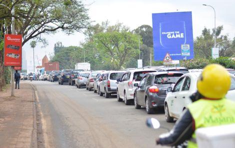 Vehicles in traffic along Uhuru Highway in Nairobi, Kenya.