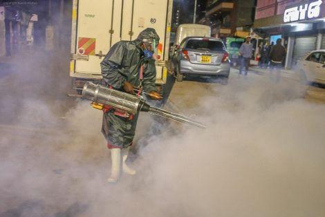 A member of Sonko Rescue Team using a steam fumigation machine