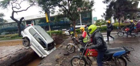 A car inside a ditch along Uhuru Highway at Nyayo Roundabout.