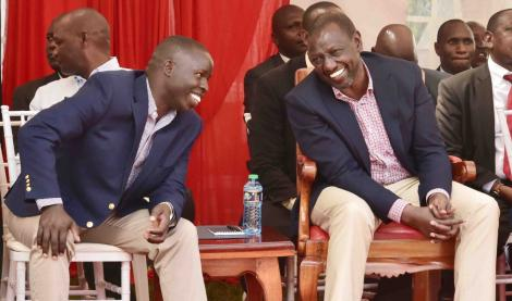 Deputy President William Ruto shares a light moment with the Nandi Governor Stephen Sang on March 13, 2020.