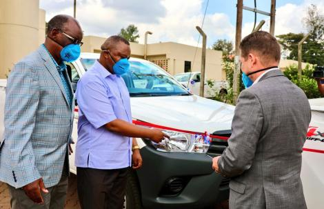 Director of Criminal Investigations (centre) receives a donation from US Ambassador Kyle McCarter on Friday, May 29, 2020