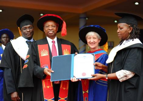 Dr. Njoroge, second from left, receives honorary doctorate from Mount Kenya University in 2014.