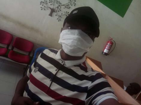 An individual wearing an improvised face mask in a photo that surfaced on Friday, March 13, 2020