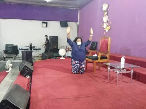 Bishop Margaret Wanjiru leads members of her church Jesus is Alive Ministries in celebrating her recovery from COVID-19.