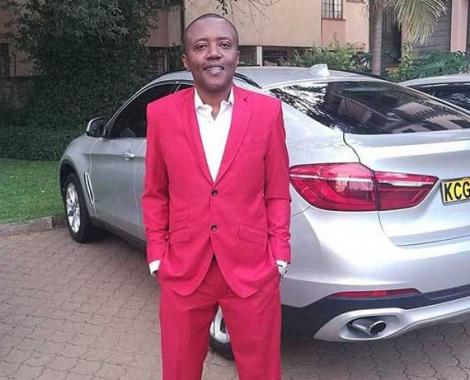 Classic FM presenter standing with his BMW X6