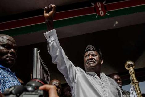 Opposition leader Raila Odinga gestures before his swearing in as the people's president on January 30, 2018 at Uhuru Park Nairobi.