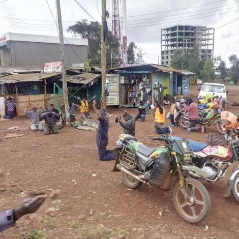 Mechanics and boda boda operators in Ruaka town kneel in prayer for the Coronavirus pandemic on Saturday, March 21, 2020.