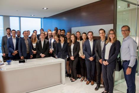 Staff at the McKinsey and Company pose for a group photo in their offices on September 9, 2016.