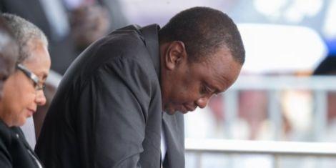 President Uhuru Kenyatta bows in prayer during a past ceremony