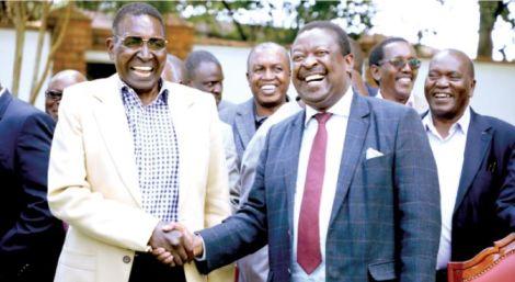 Trader Nginyo Kariuki (left) with ANC leader Musalia Mudavadi at the former's Rironi home in Kiambu, in 2019