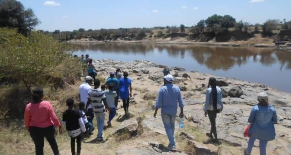 Kenya group safari walking Mara river