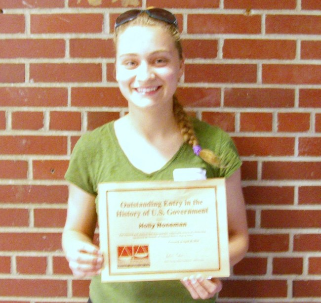 "Congratulations to Holly Noneman for receiving outstanding recognition for her individual exhibit at the National History Day competition. Holly received recognition for having ""The Outstanding Entry in the History of the United States Government""  and received a certificate and a $40.00 gift certificate to Barnes and Noble."