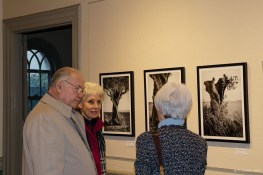 Jan talking about the photographs with John and Suzy