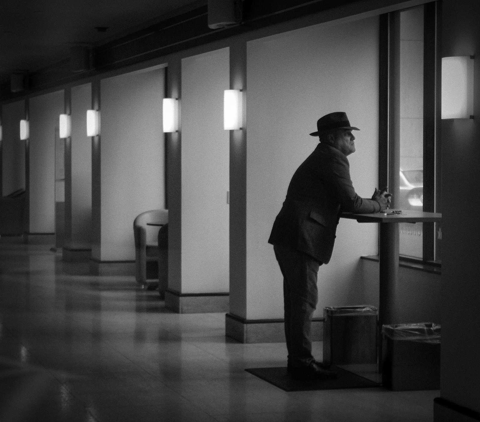 Man at Bank Window