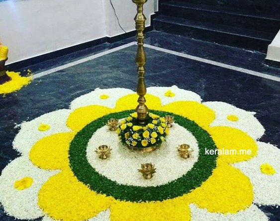 onam pookalam 2021 with white and yellow flower