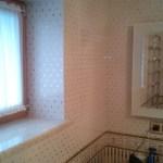 Фото укладка плитки в ванной - работа плиточника