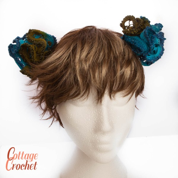 pair of frilly blue and green hairbands