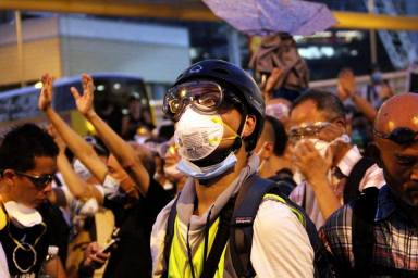 Protester with protective gear (Photo by Dan Garrett)