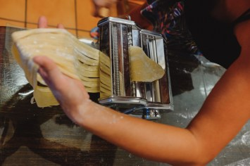 Cutting pasta (by Guang-Hui Chuan of GSquaredTravel)