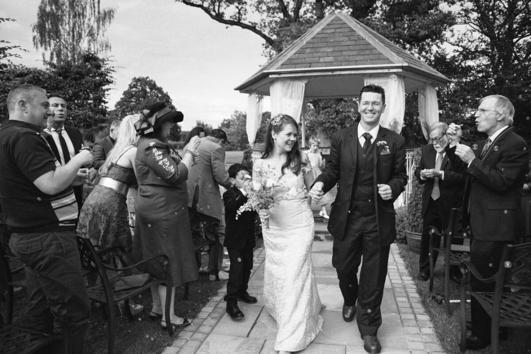 Bride and groom getting showered in confetti at Lemore Manor Weddings
