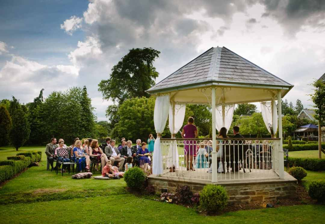 Outdoor garden ceremony wedding at Lemore Manor