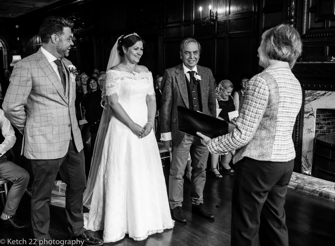 Groom smiling at bride during wedding ceremony at Whitney Court in Herefordshire