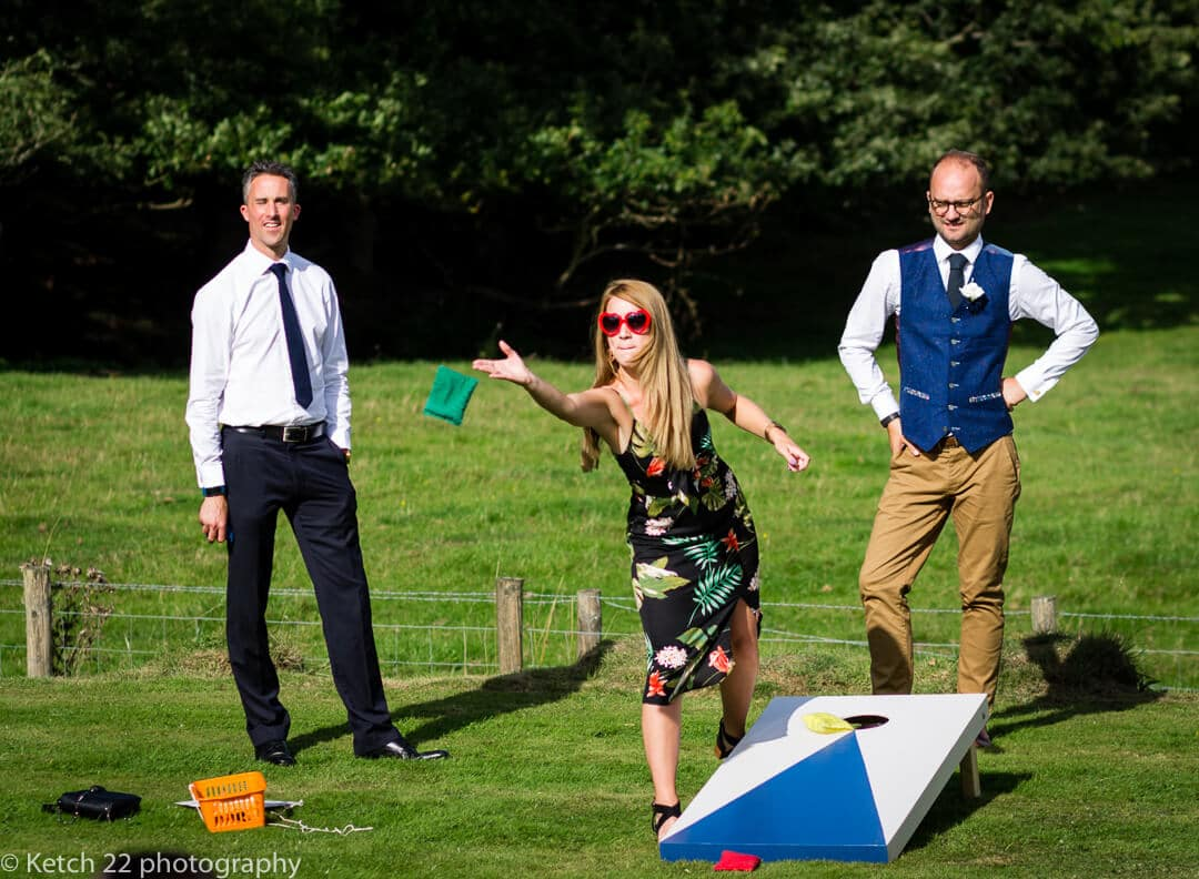 Wedding guests playing games on lawn in Herefordshire