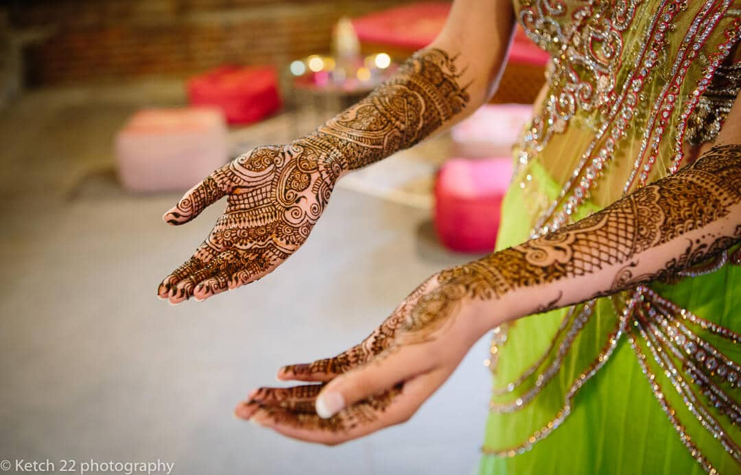 Hindu bride painted hands and arms at Indian Henna night