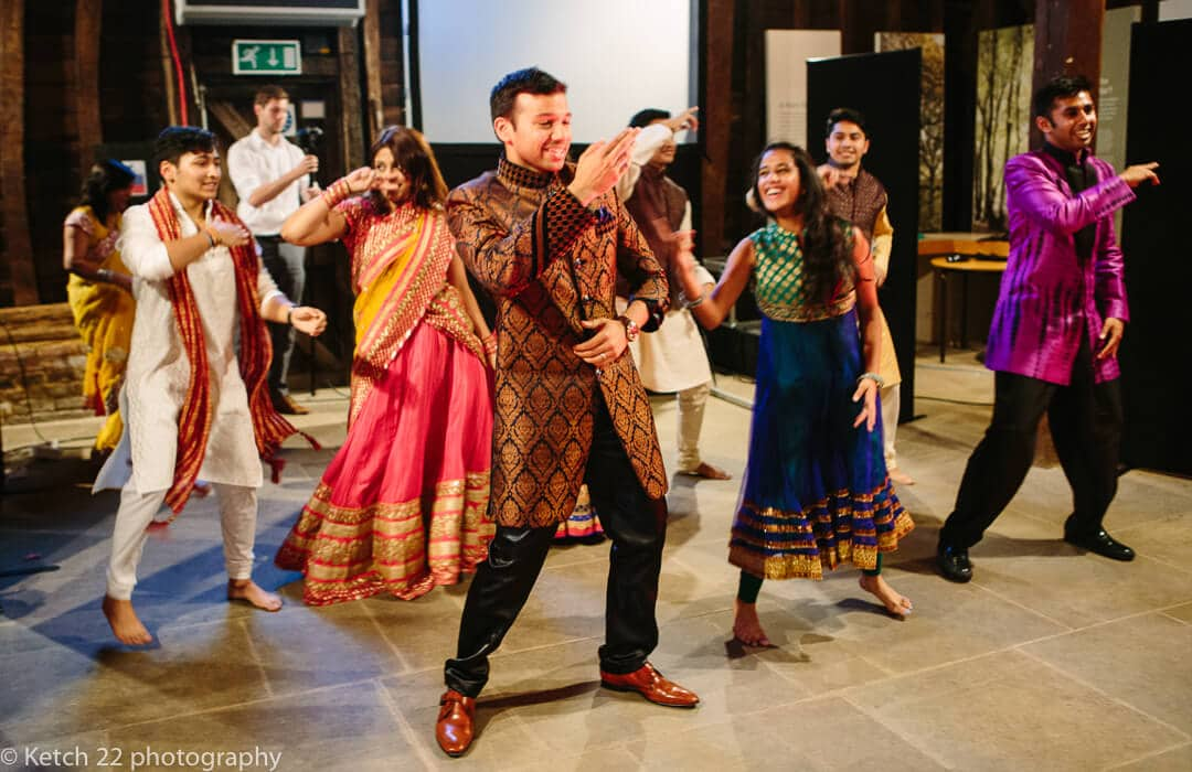 Groom dancing with performers at Henna evening